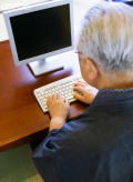 Older man by computer